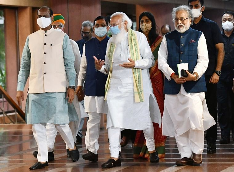 Prime Minister Narendra Modi with Lok Sabha Speaker Om Birla and TMC MP Sudip Bandyopadhyay after a meeting with leaders of the parties in Lok Sabha on the eve of monsoon session of Parliament, at Library building in New Delhi