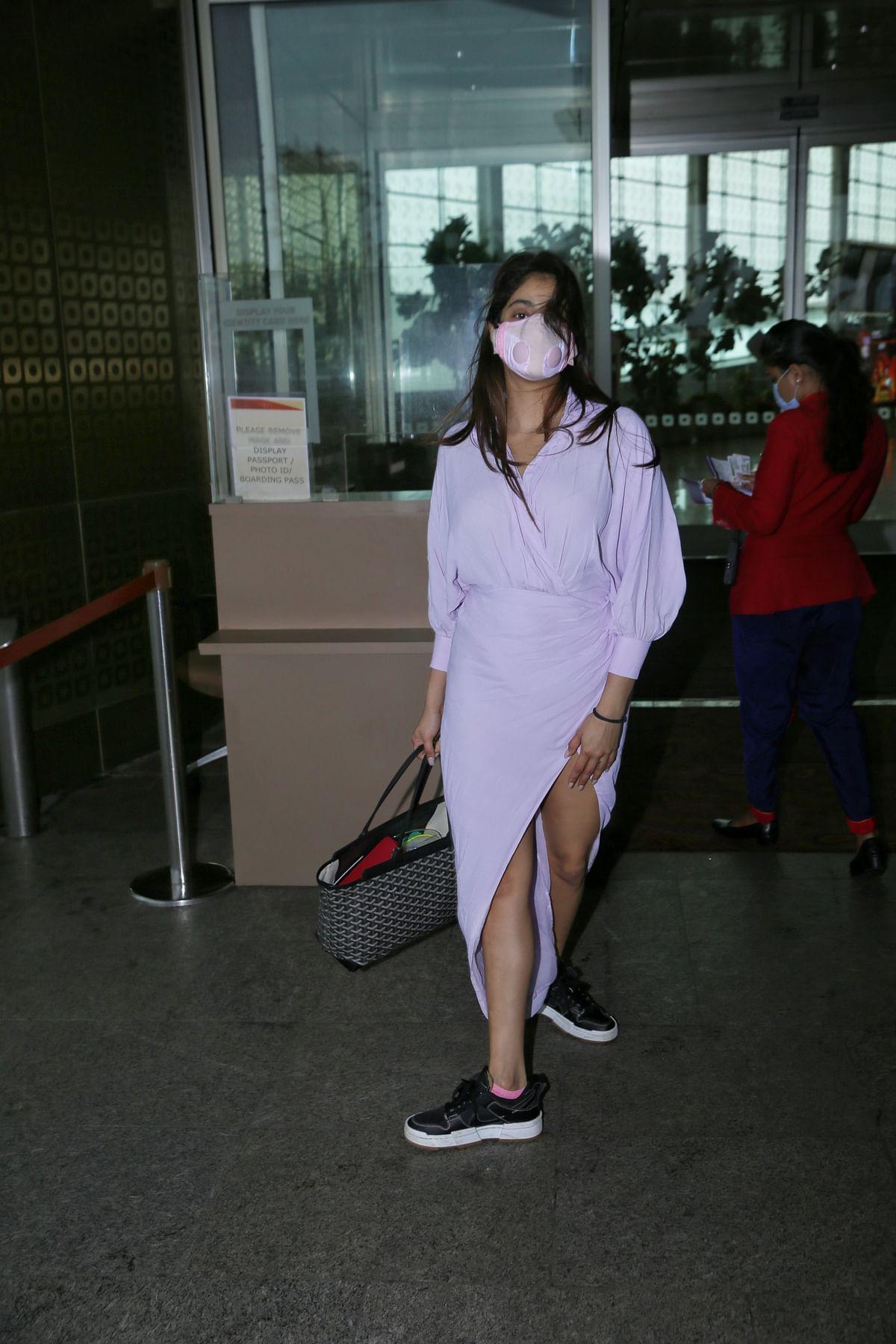 In Pics: Jacqueline Fernandez sashays at Mumbai airport in figure-hugging Fendi dress; Janhvi Kapoor opts for thigh-high slit lilac dress