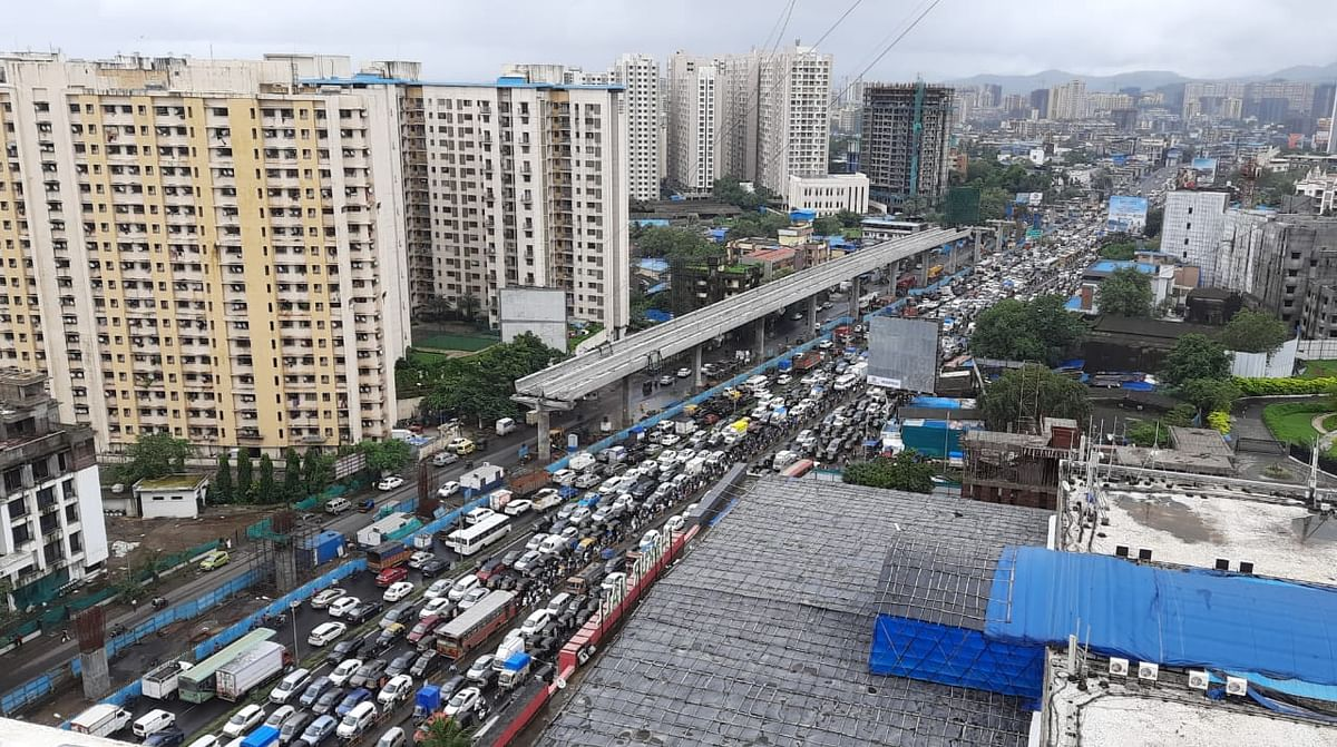 Vehicles stuck in a traffic jam on Western Express Highway after heavy rain in Mumbai, Friday, July 16, 2021.