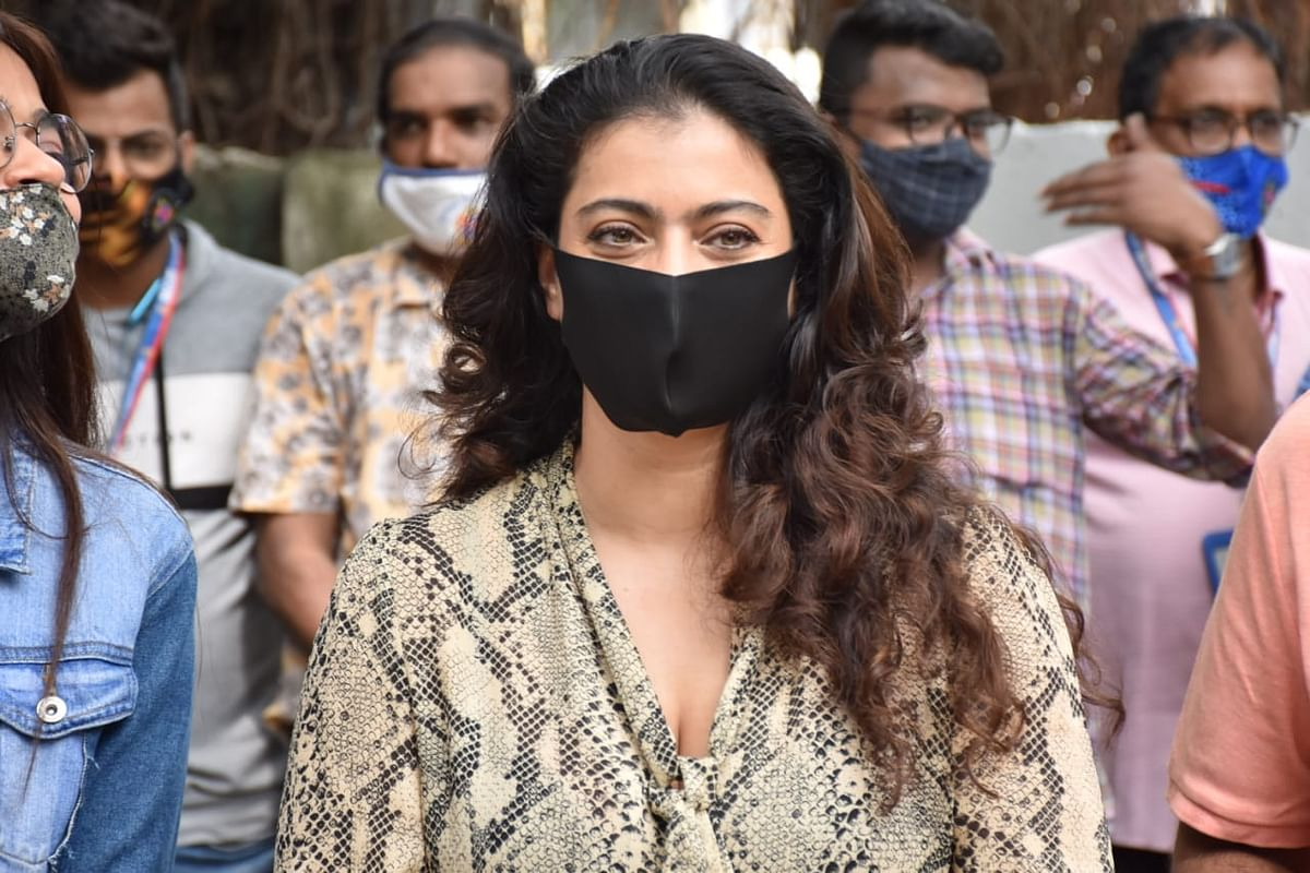 Watch: Kajol requests paparazzi to maintain social distancing as she steps out in Mumbai to distribute raincoats to BMC employees