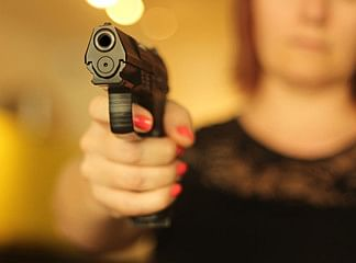 A country-made pistol and 15 live rounds were recovered from her residence where she was living alone