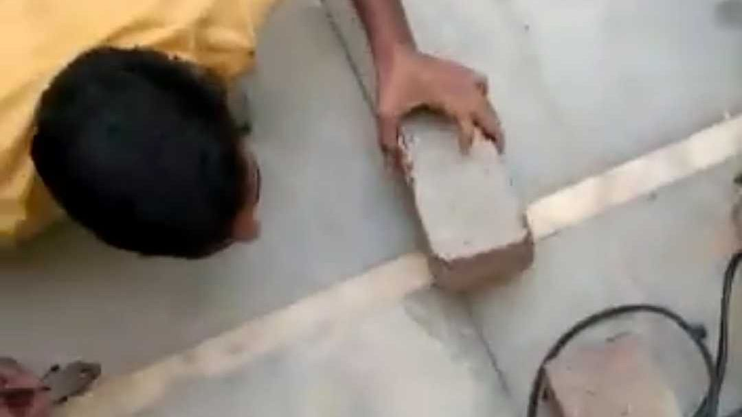 Watch Video: Man caught cutting wire connected to illegal power source to erase evidence of electricity theft
