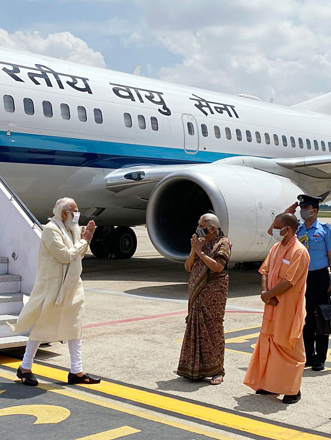 Prime Minister Narendra Modi being received at the airport by Uttar Pradesh Governor Anandiben Patel, CM Yogi Adityanath, and other dignitaries, in Varanasi on Thursday.