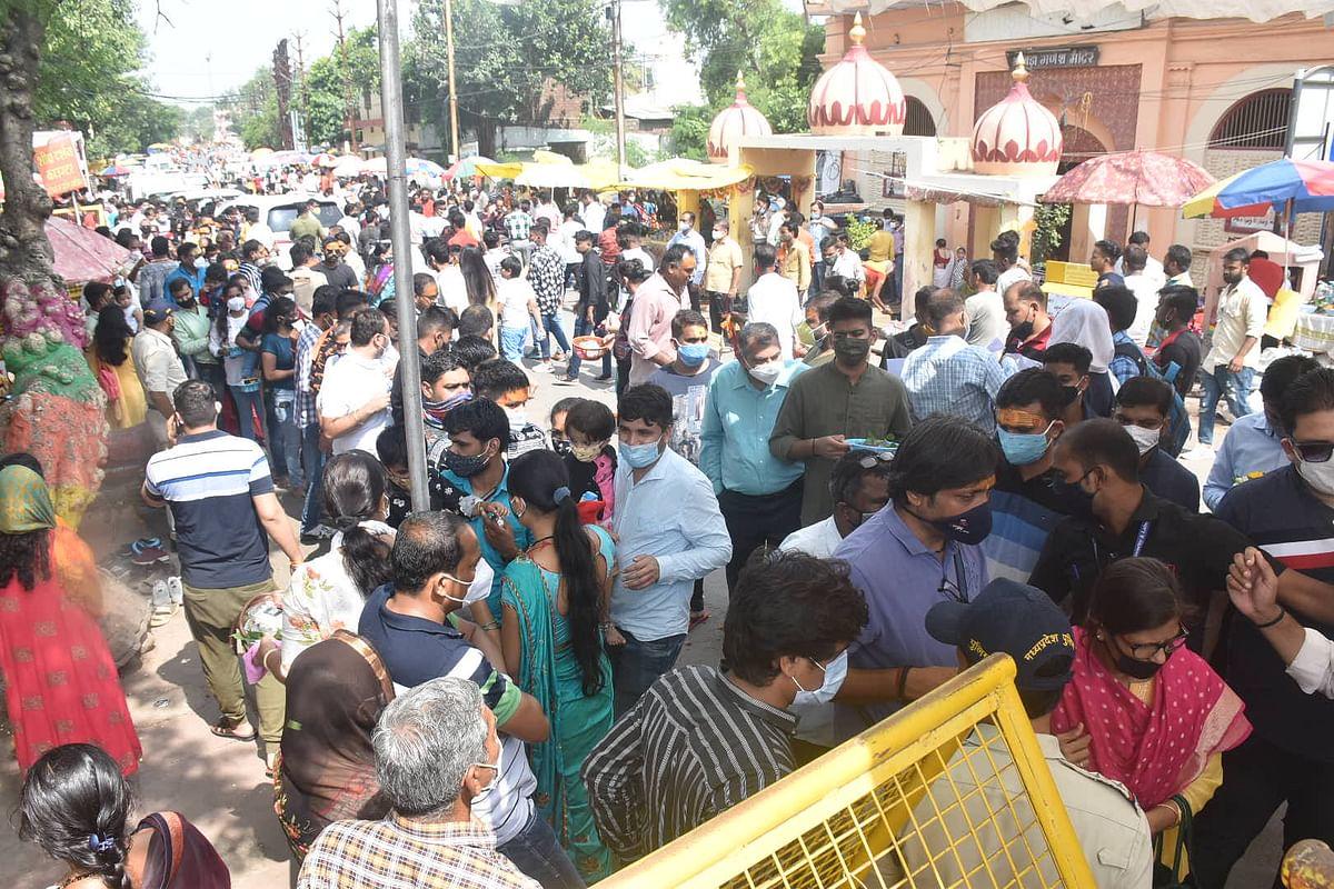 Devotees wait their turn for darshan of presiding deity at Mahakal Temple in Ujjain on Sunday