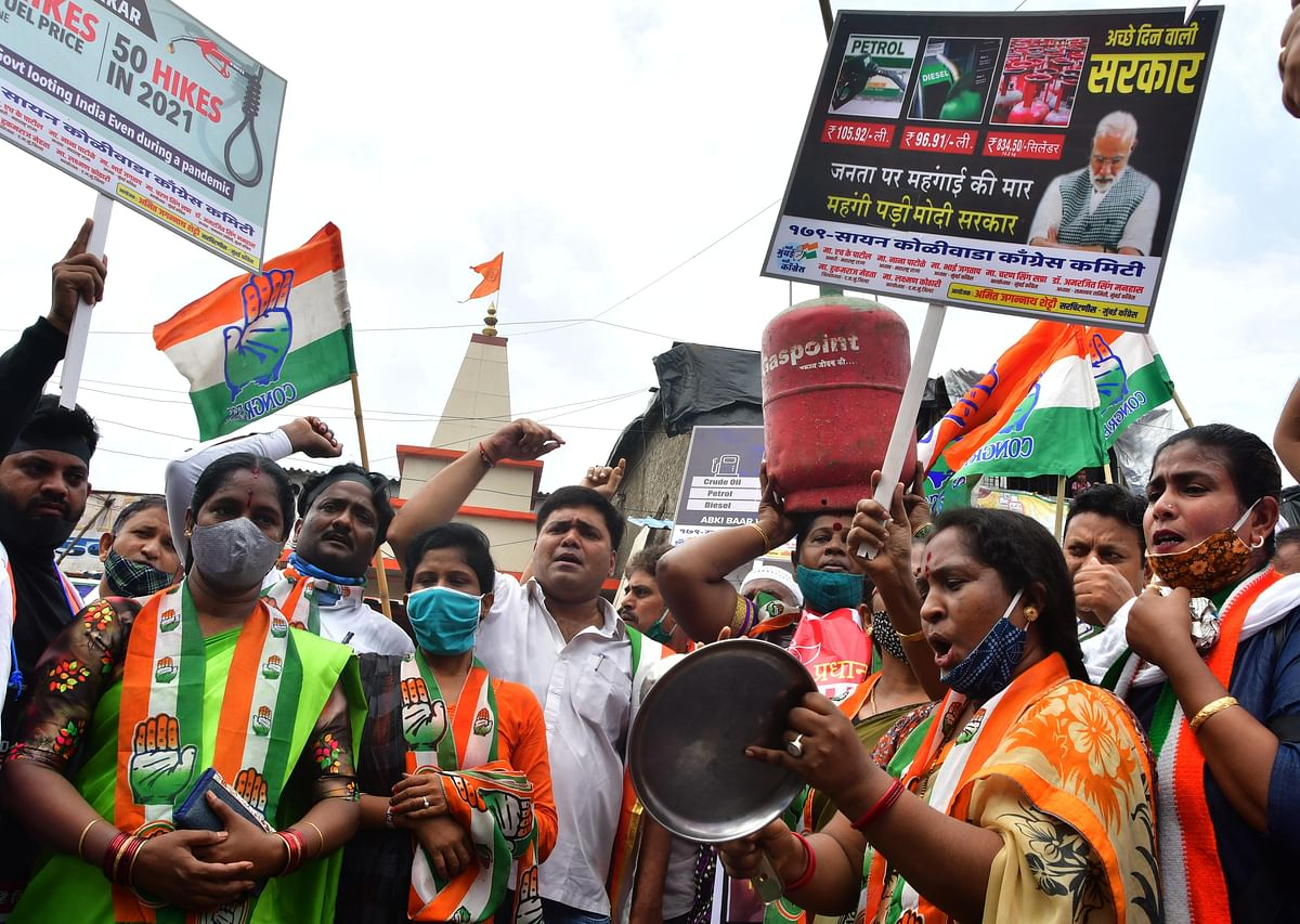 Mumbai Congress activists shout slogans during protests against the fuel and cooking gas price hike at Antop Hill, in Mumbai, on Wednesday, July 07, 2021.