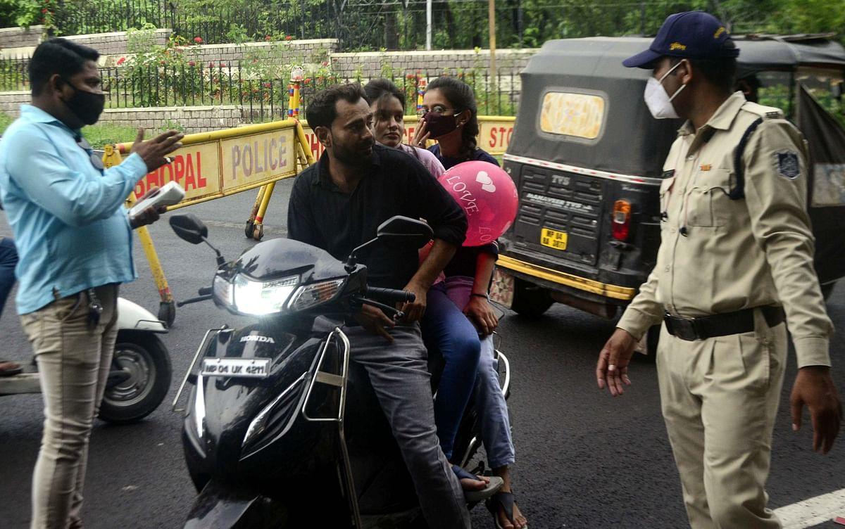 Cop checking Covid protocol violation at Shayamla Hills in Bhopal on Friday.