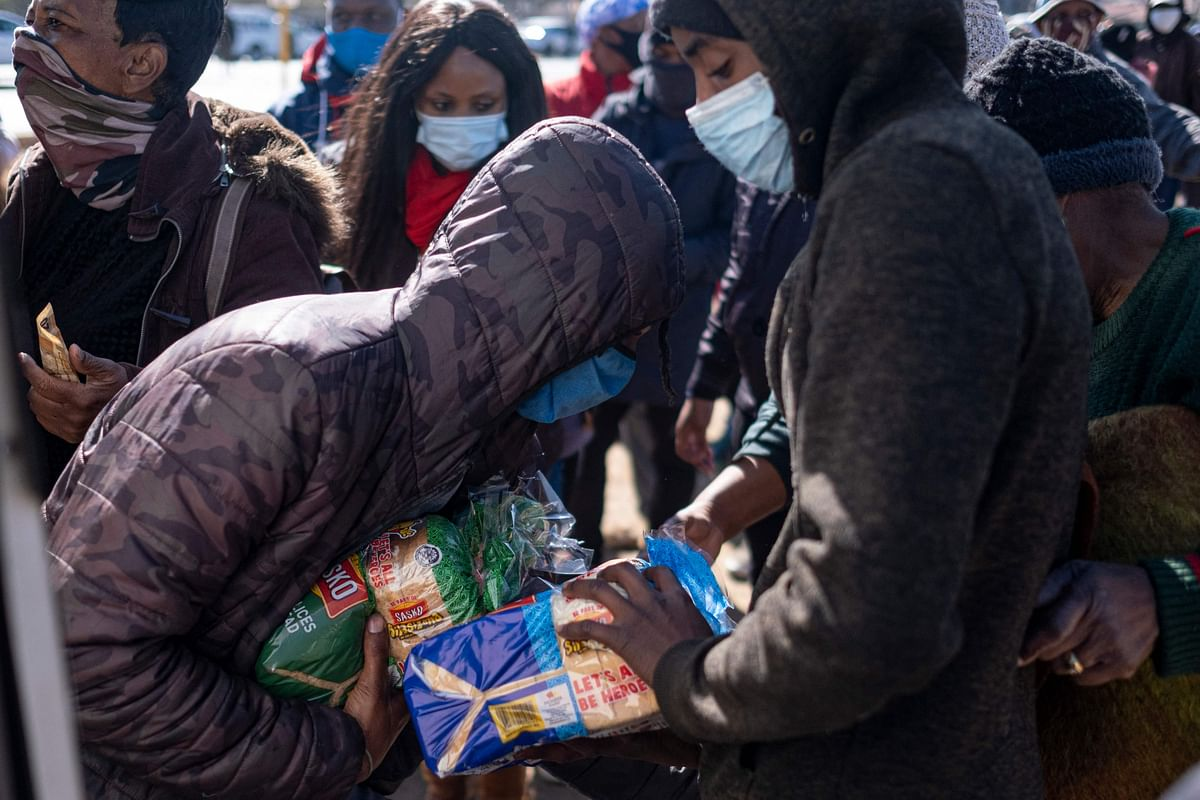 Residents of Soweto buy bread from a truck as shops and malls in Soweto are looted and closed for business on July 14, 2021.