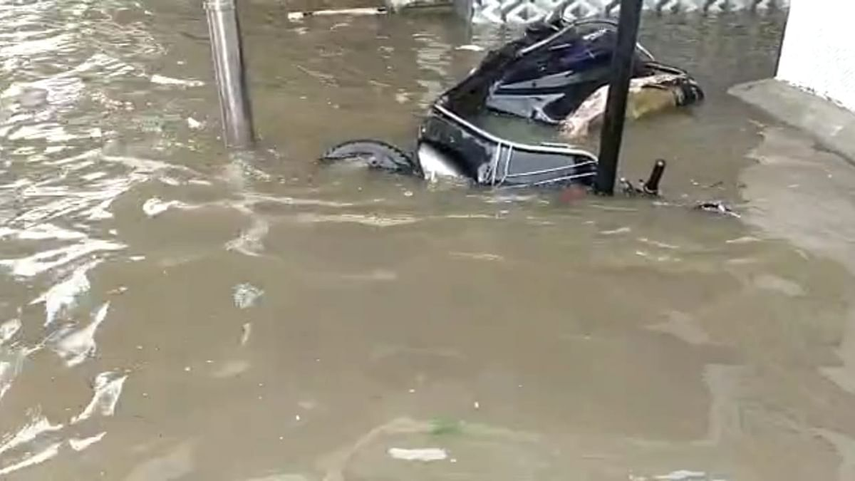 A scooty parked on a street submerges into water at Hindmata, Lower Parel as heavy rainfall causes water-logging on Friday, July 16, 2021.