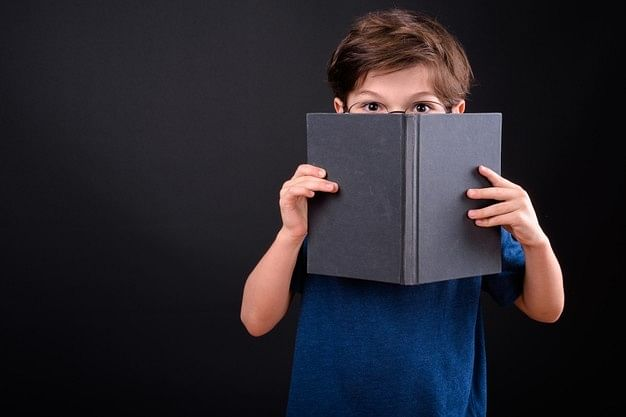 Little author and his 'legendary' book of riddles and games