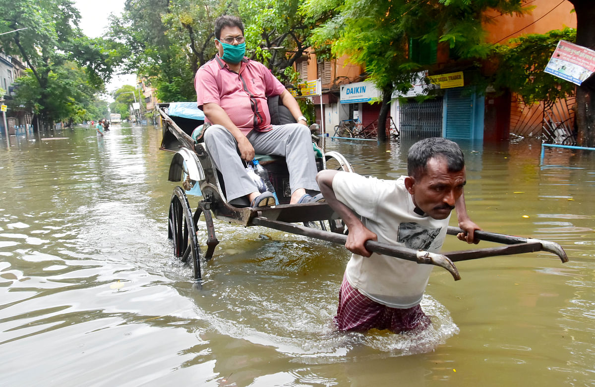 West Bengal: Incessant rainfall throws normal life out of gear; see pics