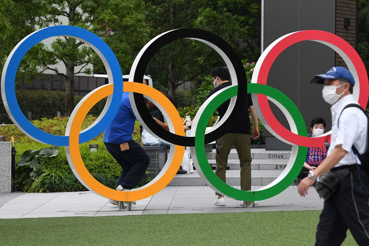 The Olympic rings is displayed near the National Stadium, main venue for the Tokyo 2020 Olympic and Paralympic Games in Tokyo on July 7, 2021, as reports said the Japanese government plans to impose a virus state of emergency in Tokyo during the Olympics.