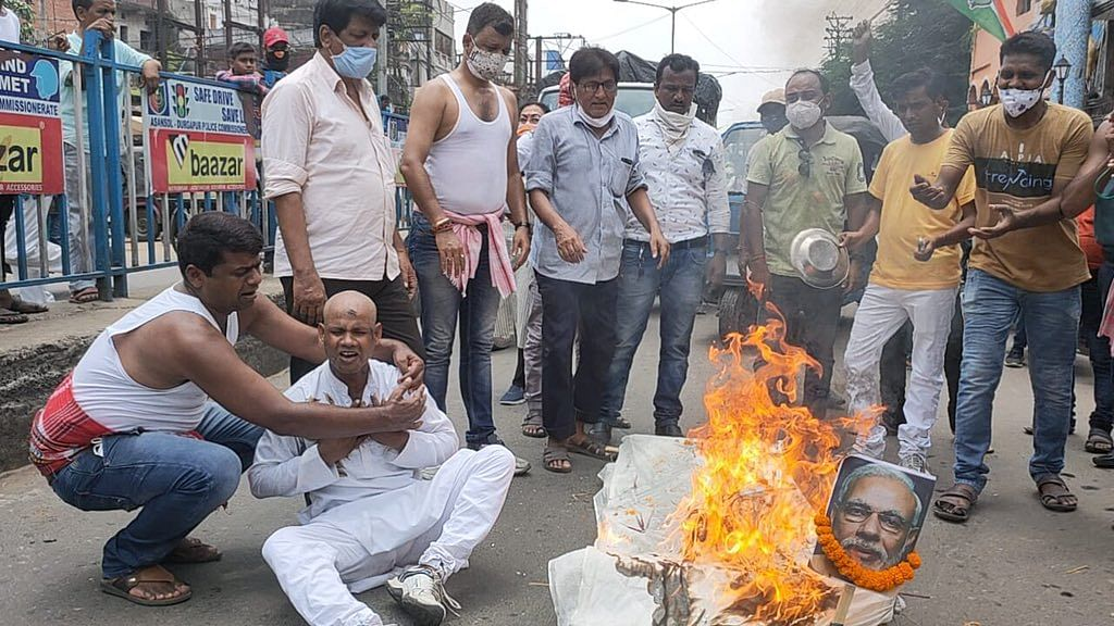 Congress workers stage protests against the constantly rising fuel prices in Asansol, West Bengal on Wednesday, July 7, 2021.