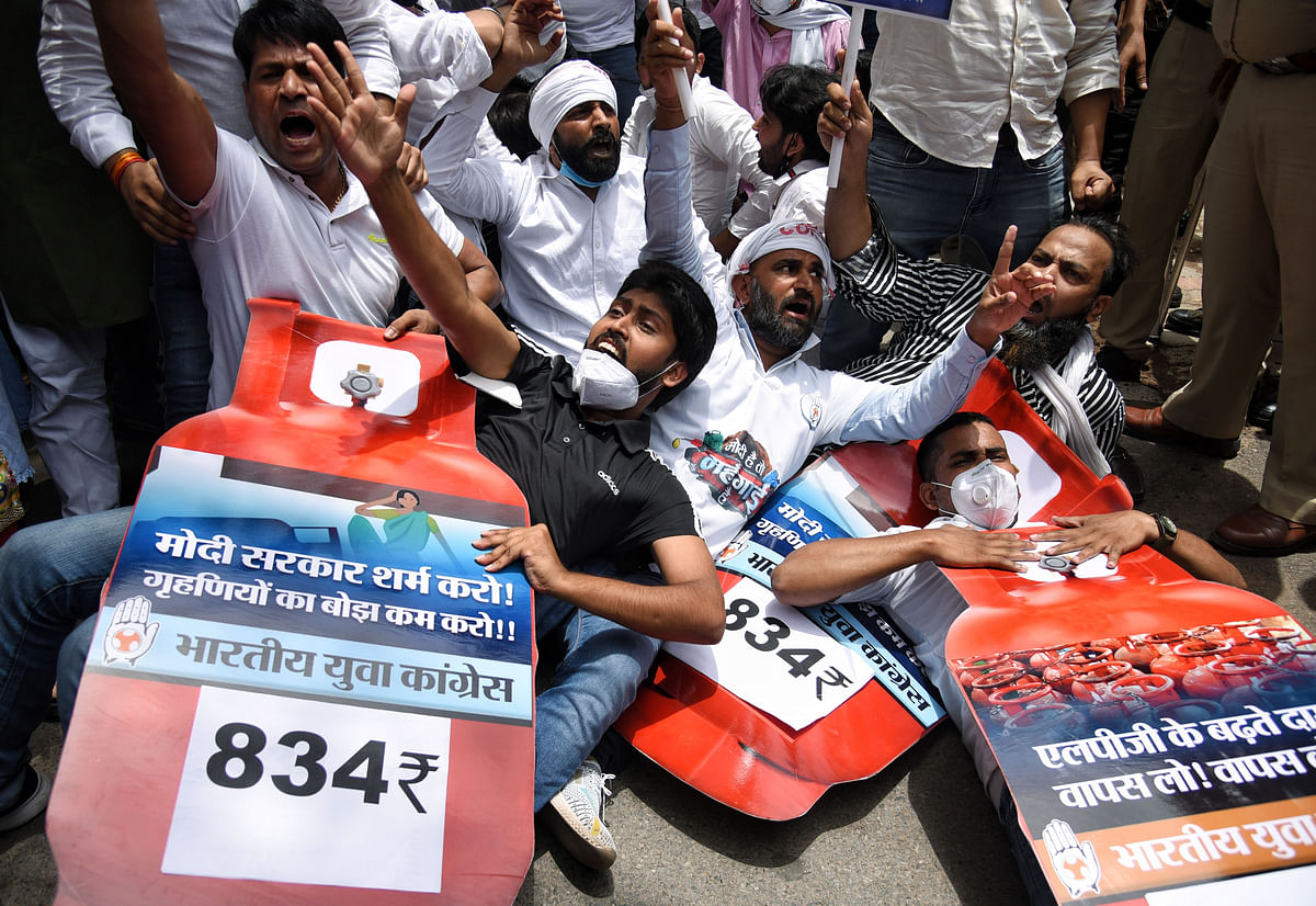 Indian Youth Congress (IYC) supporters stage a protest against the hike in fuel prices outside Shastri Bhawan, in New Delhi on Saturday.