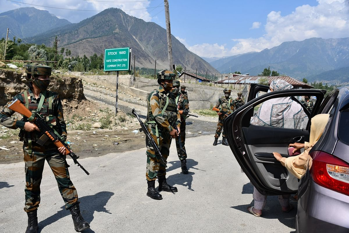 The soldiers screen commuters at Wasun, in Ganderbal district of Kashmir