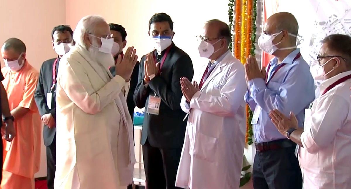 Prime Minister Narendra Modi greets the doctors during his visit to the 100-bed maternal & child health wing at Banaras Hindu University, in Varanasi on Thursday.
