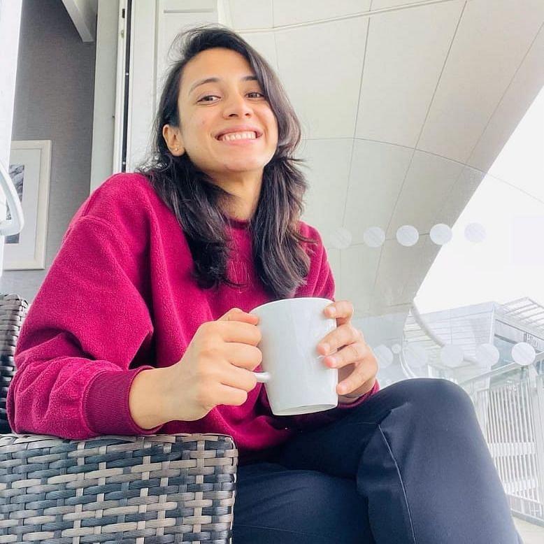 Smriti Mandhana enjoying a hot beverage