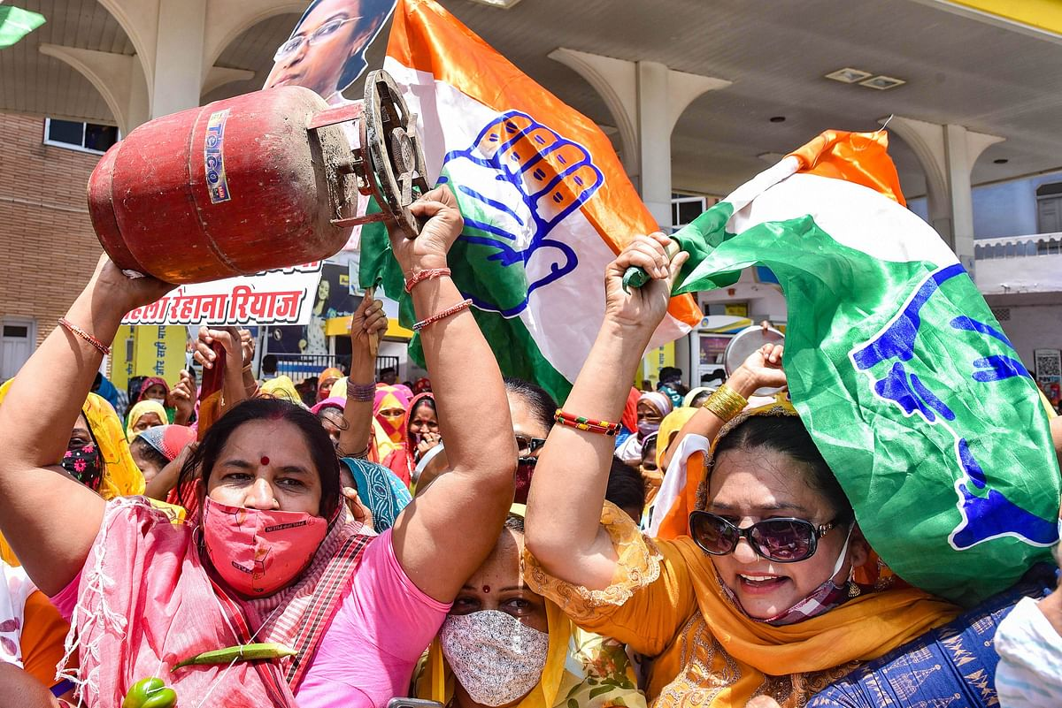 Congress workers stage a protest against hike in the fuel prices, in Bikaner, Rajasthan on Wednesday, July 7, 2021.