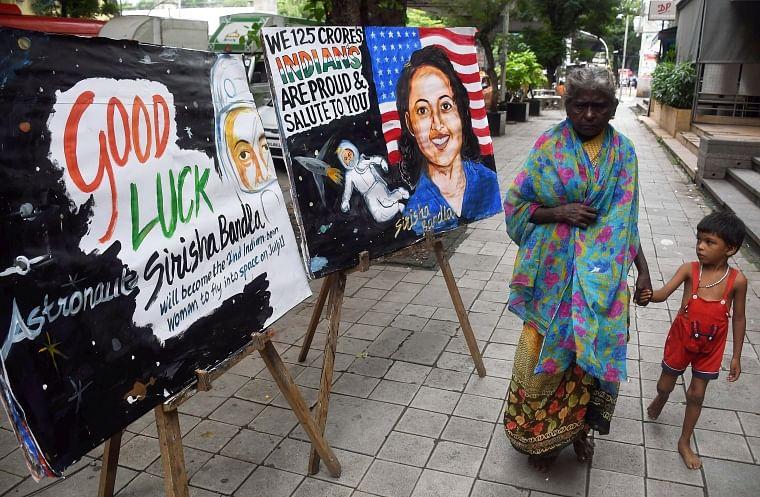 An artist shows respect to Sirisha Bandla in Mumbai on Saturday.
