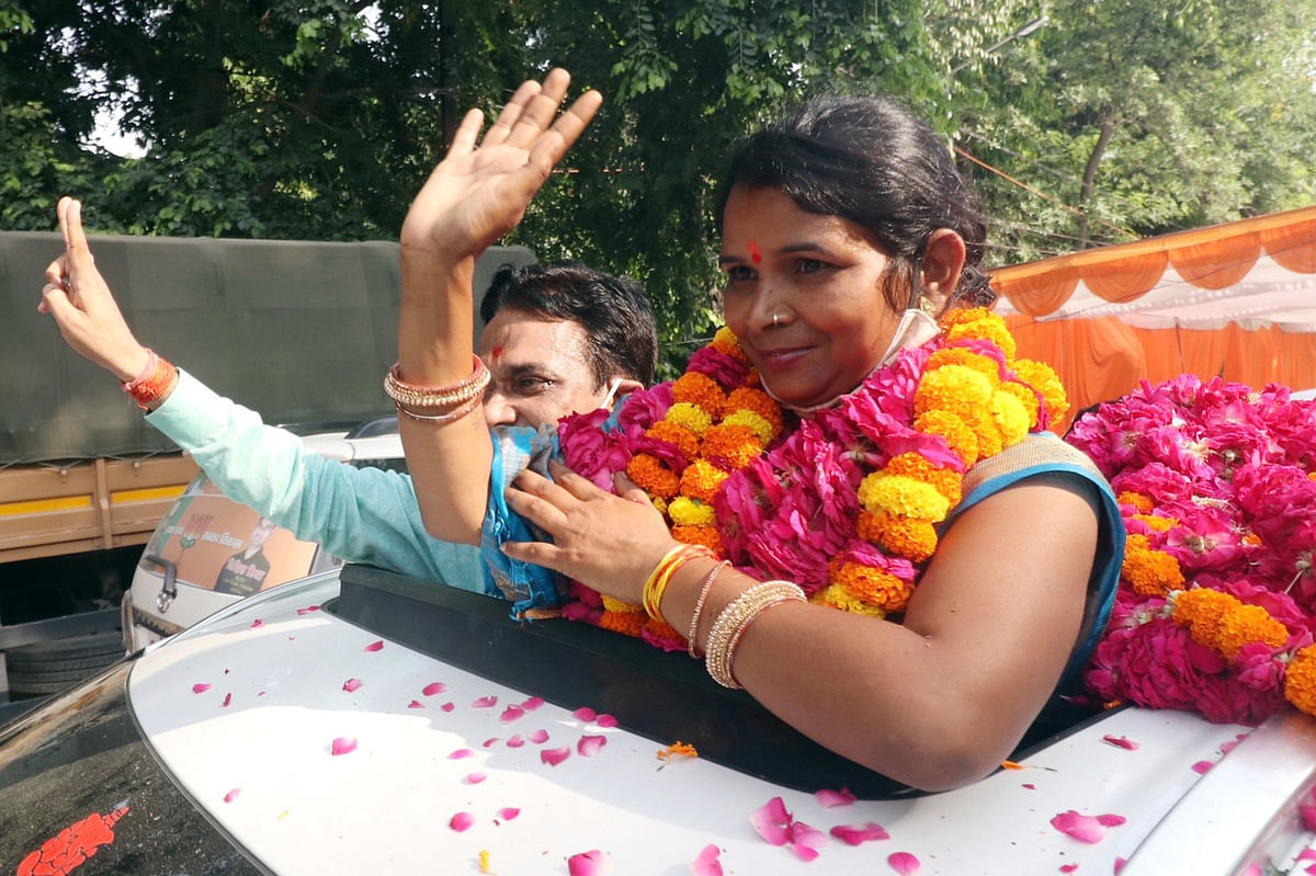 Uttar Pradesh, July 03 (ANI): Bharatiya Janata Party candidate Arti Rawat waves outside of District Collectorate as she wins in Jila Panchayat election, in Lucknow on Saturday.