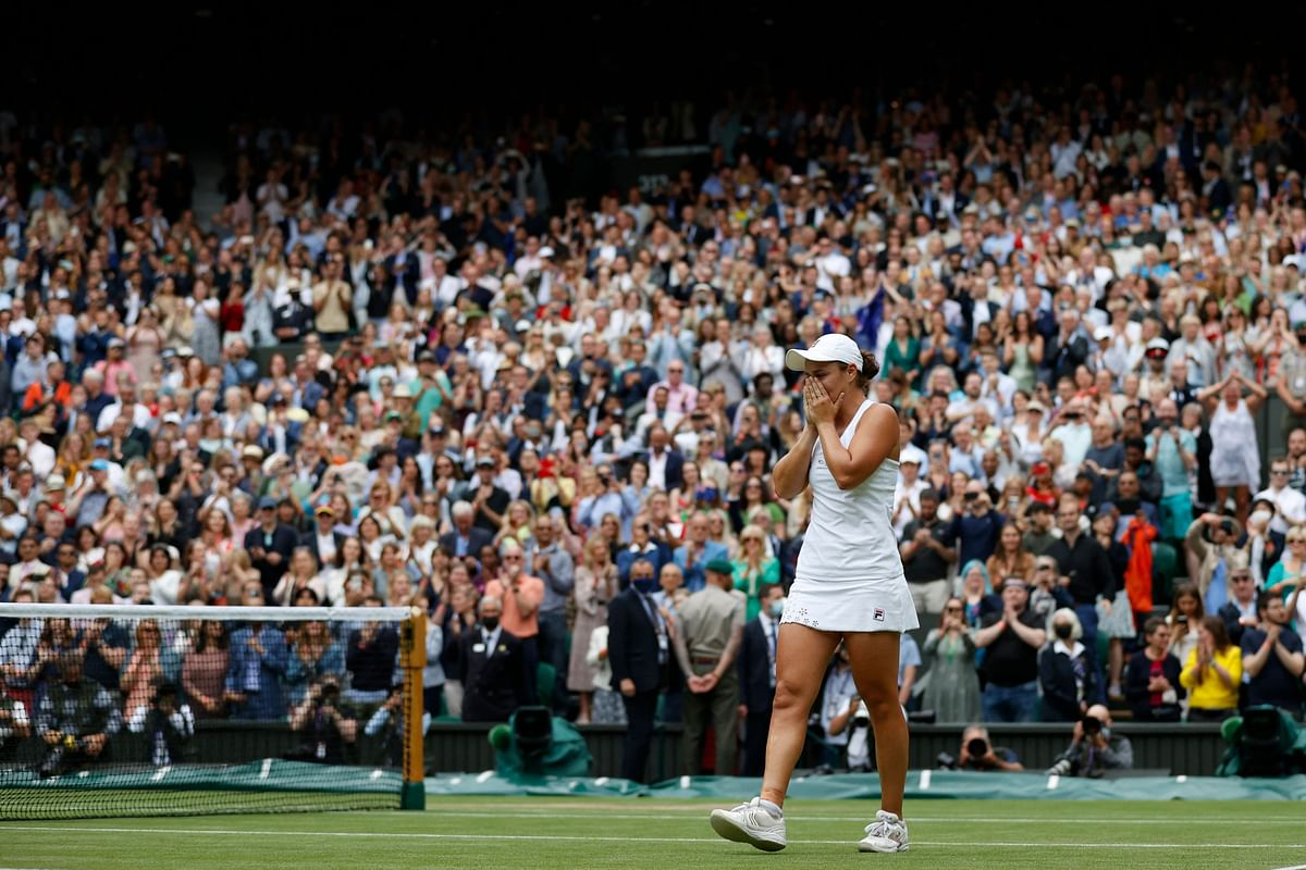 Australias Ashleigh Barty celebrates her win against Czech Republics Karolina Pliskova during their womens singles final match on the twelfth day of the 2021 Wimbledon Championships at The All England Tennis Club in Wimbledon, southwest London, on July 10, 2021.