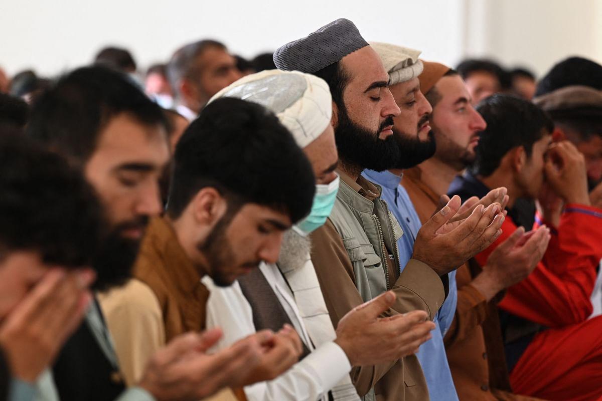 Afghan Muslim devotees offer their Eid al-Adha prayers inside a mosque in Kabul on July 20, 2021.