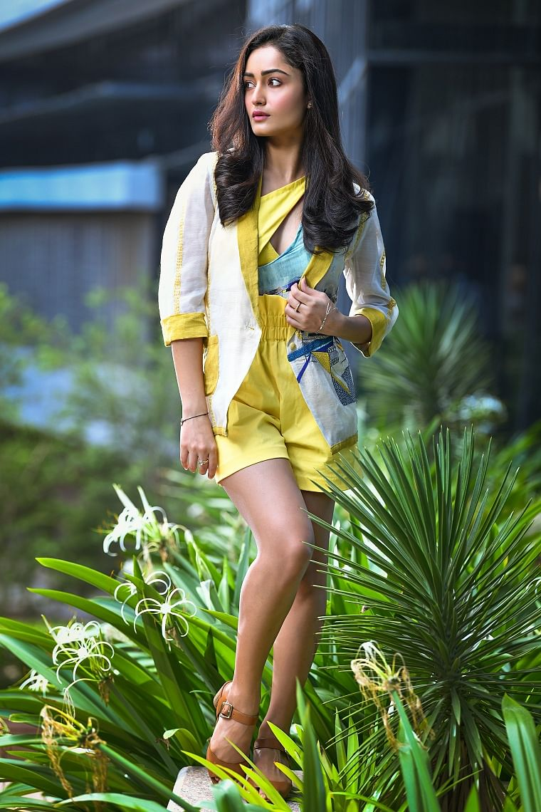 Asymmetrical monokini teamed with a hand-embroidered  chanderi lapel jacket and high-waist blommer shorts