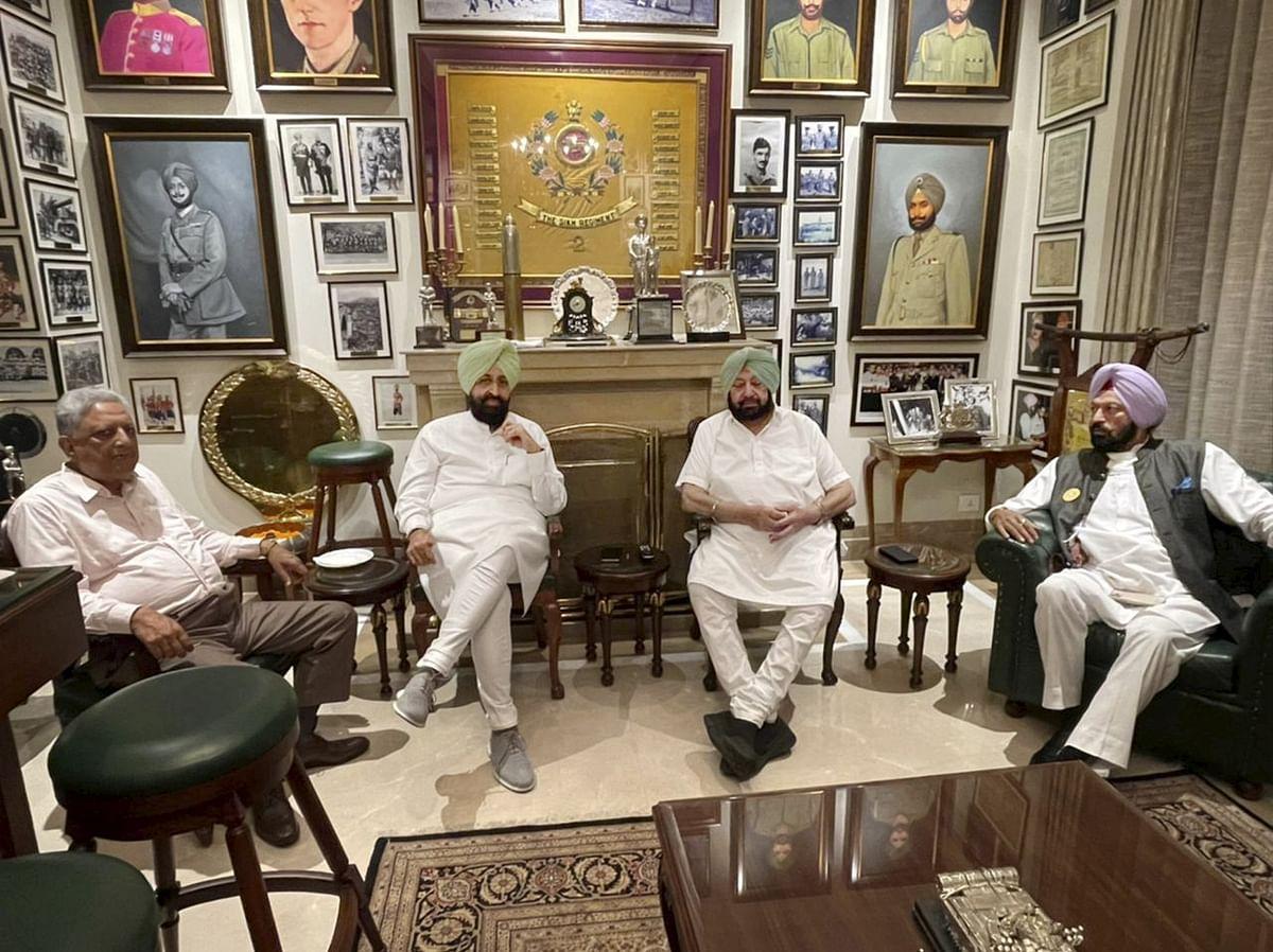Chandigarh: Punjab Speaker Rana K.P Singh, Rajya Sabha MP and former PPCC president Pratap Singh Bajwa and cabinet minister Rana Gurmeet Sodhi with state Chief Minister Capt. Amarinder Singh, in Chandigarh, Saturday, July 17, 2021.