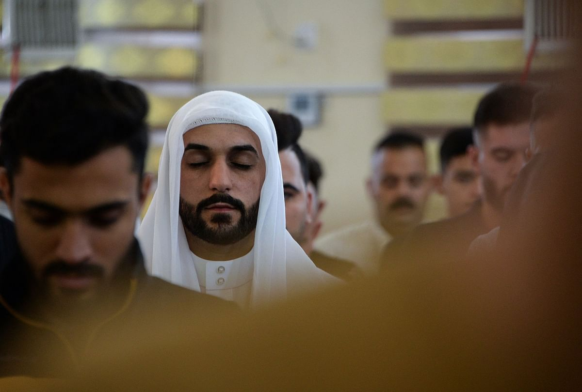 Iraqi worshippers perform the al-Adha feast prayers on the first day of the feast celebrated by Muslims worldwide, at the Mohammed Alamine mosque in the northern city of Mosul, on July 20, 2021.
