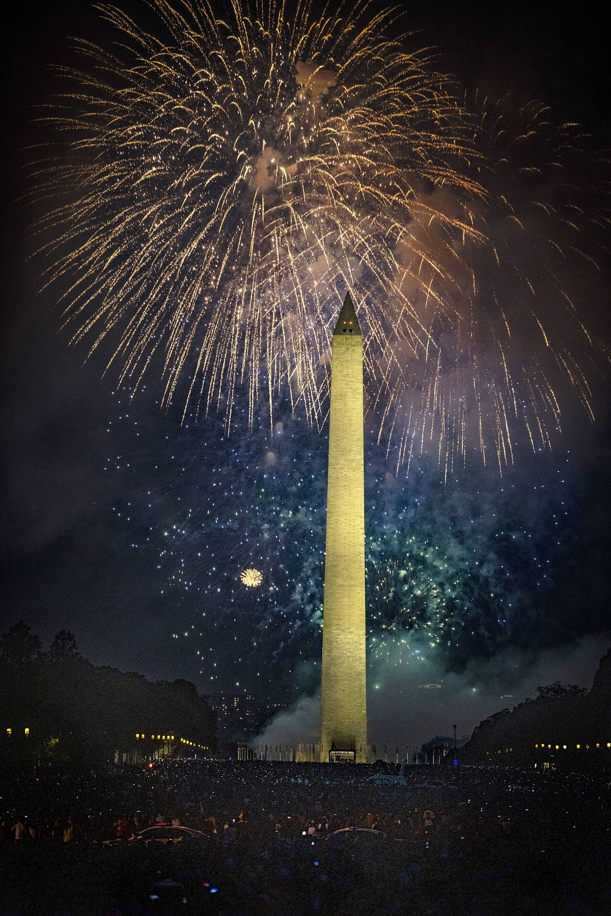 People fill the National Mall to watch the fireworks display during Independence Day celebrations on July 4, 2021 in Washington, DC.