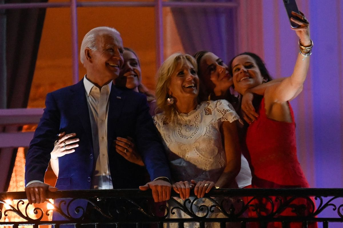 US President Joe Biden (L), First Lady Jill Biden (C), daughter Ashley Biden (R) and granddaughters Finnegan Biden (2nd L) and Naomi Biden pose for a selfie during Independence Day celebrations at the White House in Washington, DC, July 4, 2021.