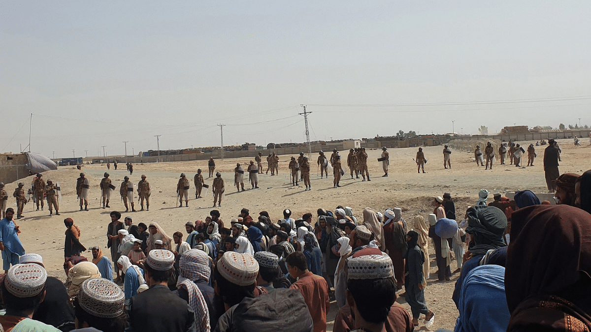 Pakistan border guards used tear gas on July 15 to disperse hundreds of people who tried to storm a border crossing with Afghanistan, a day after the Taliban seized control of the Afghan side of the frontier, officials said.