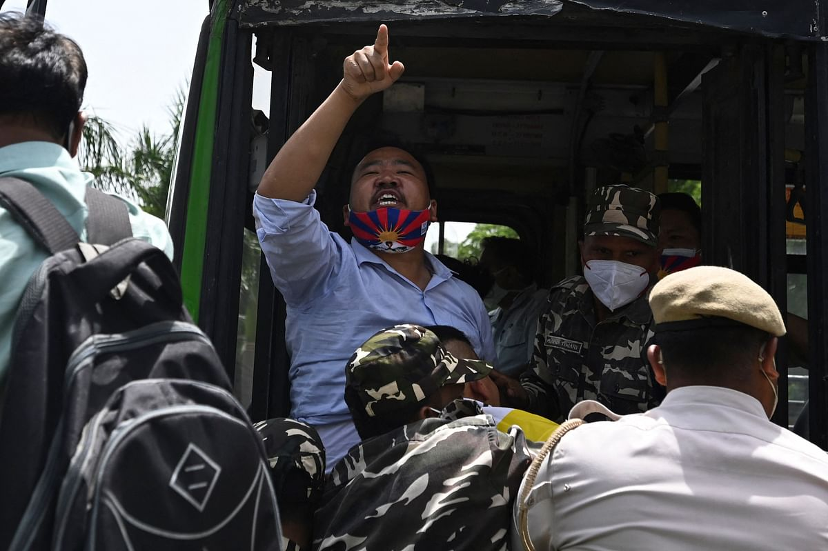 Activists of the Tibetan Youth Congress (TYC) international non-governmental organization shout slogans as they are detained by police during a protest outside the China embassy on the occasion of the 100th anniversary of the founding of the Chinese Communist party, in New Delhi on July 1, 2021.