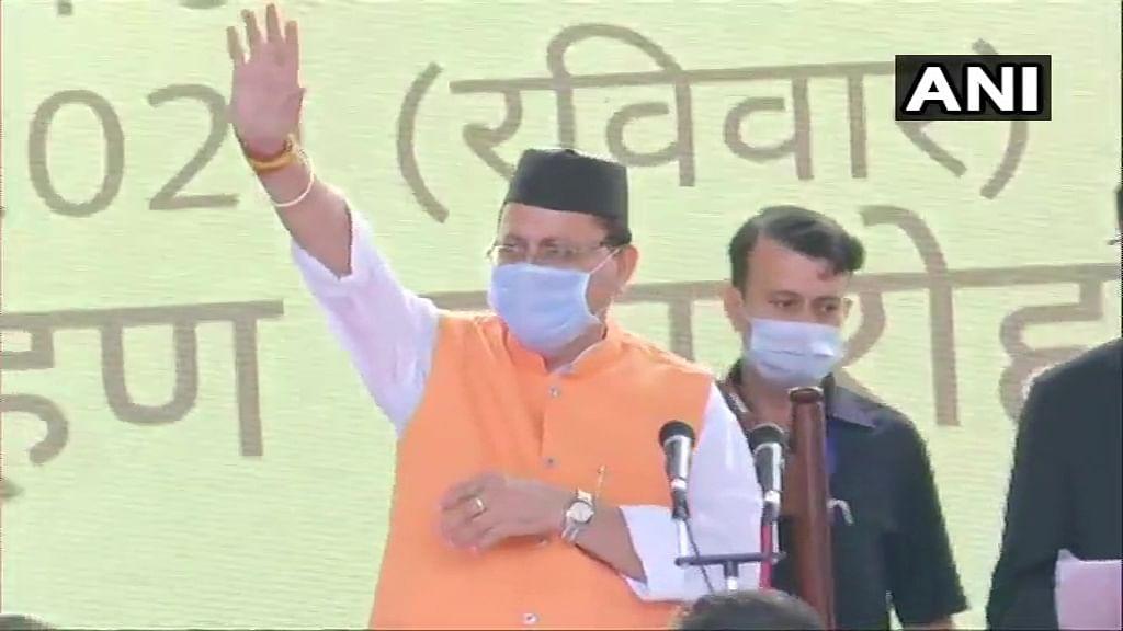 BJPs Pushkar Singh Dhami takes oath as 11th Chief Minister of Uttarakhand at Raj Bhawan, in Dehradun on Sunday.