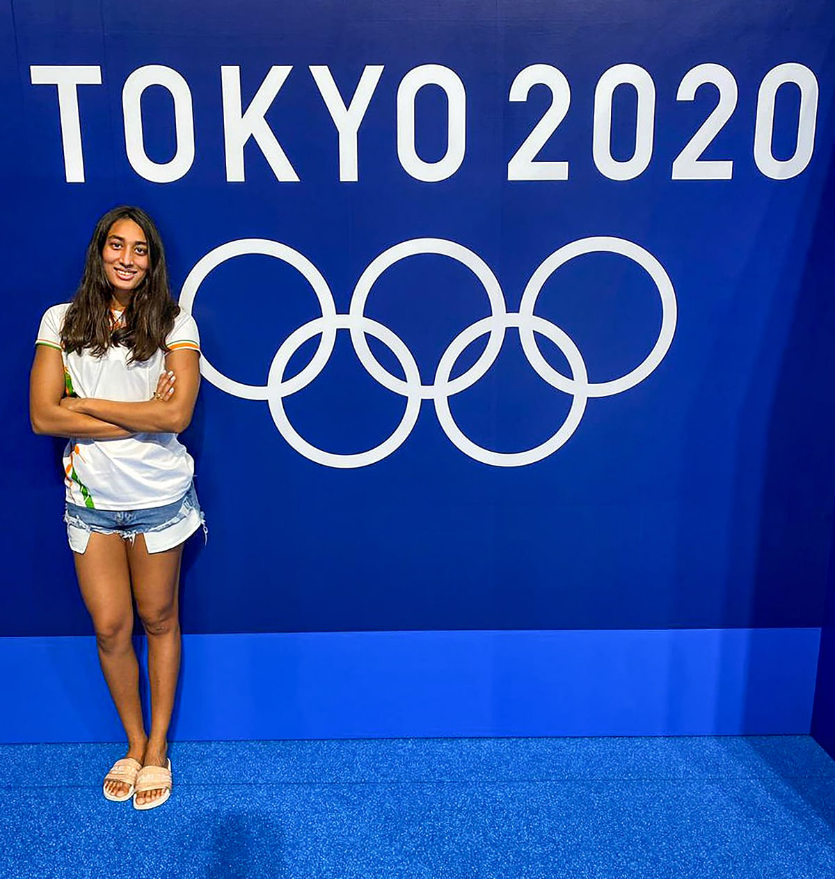Indian Swimmer Maana Patel poses for a picture ahead of her first training session at Games village in Tokyo