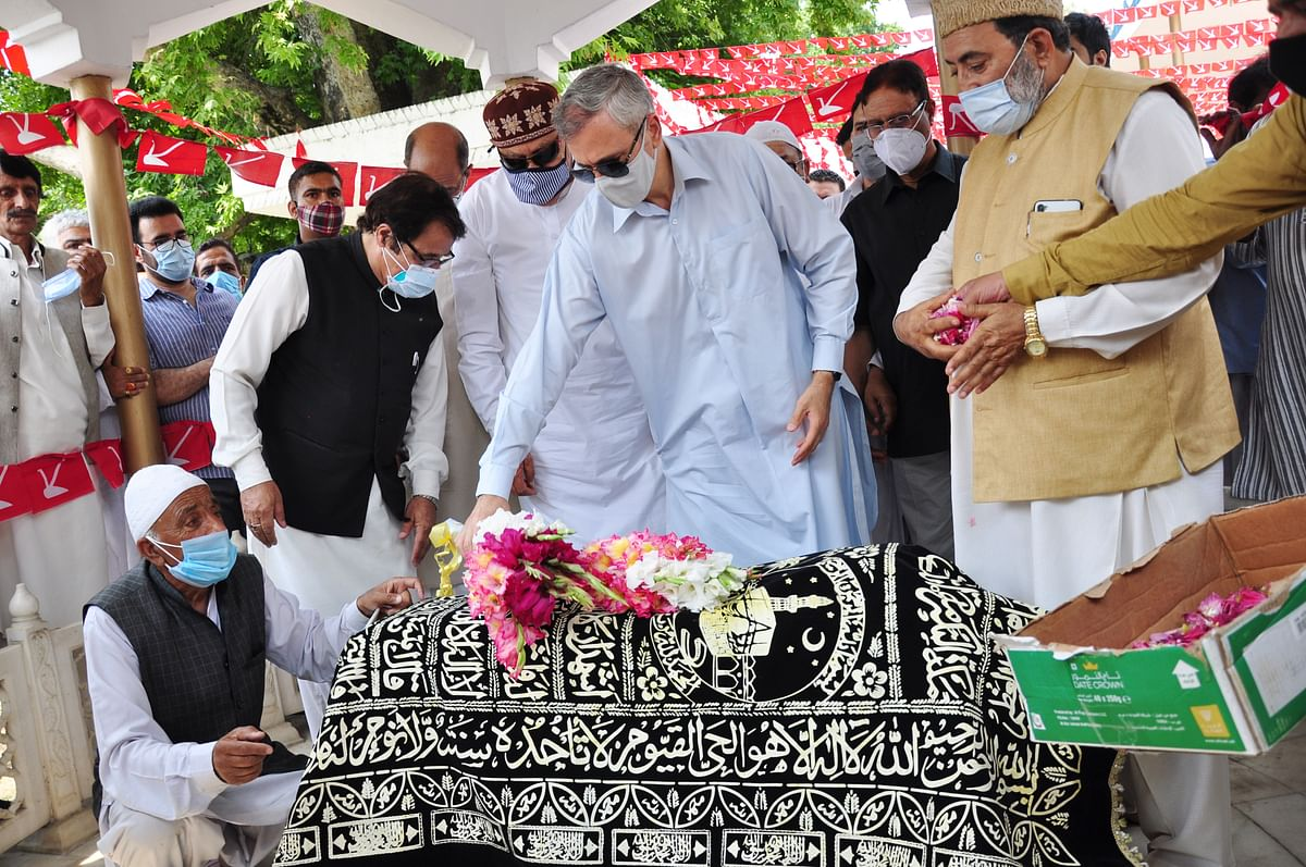 Jammu and Kashmir National Conference President and MP Dr. Farooq Abdullah, son Omar Abdullah, and senior party leaders pay tributes to Begum Akbar Jehan, MP and wife of JKNC founder Sheikh Muhammad Abdullah on her 21st death anniversary at her grave Hazratbal in Srinagar on Sunday, July 11,2021.