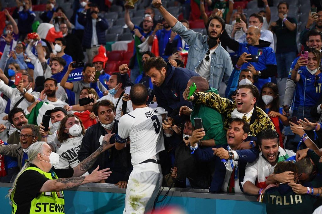 Chiellini celebrating with the Italy fans after the final whistle against Belgium