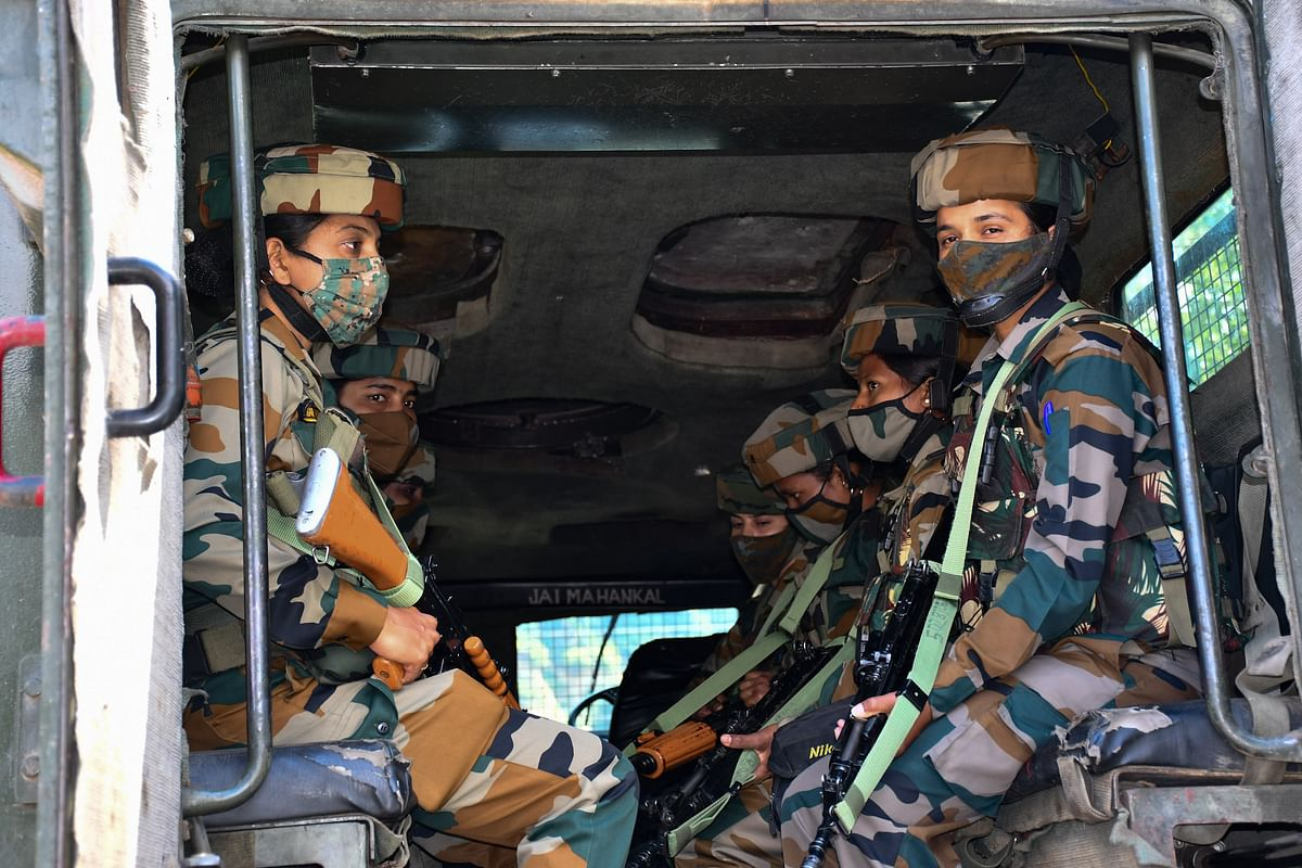 The soldiers on guard in an armoured vehicle along Srinagar-Leh highway at Wasun in Ganderbal district of Kashmir