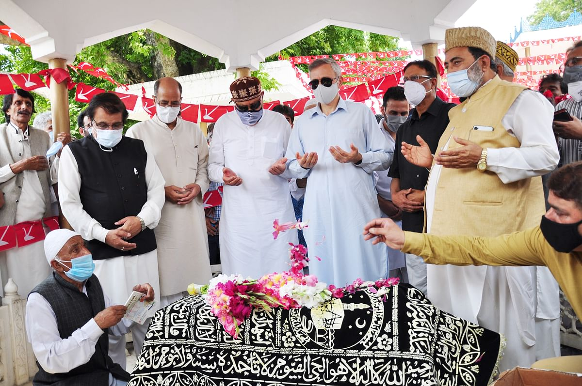 Jammu and Kashmir National Conference President and MP Dr. Farooq Abdullah, son Omar Abdullah, and senior party leaders pay tributes to Begum Akbar Jehan, ex-MP and wife of JKNC founder Sheikh Muhammad Abdullah on her 21st death anniversary at her grave Hazratbal in Srinagar on Sunday, July 11,2021