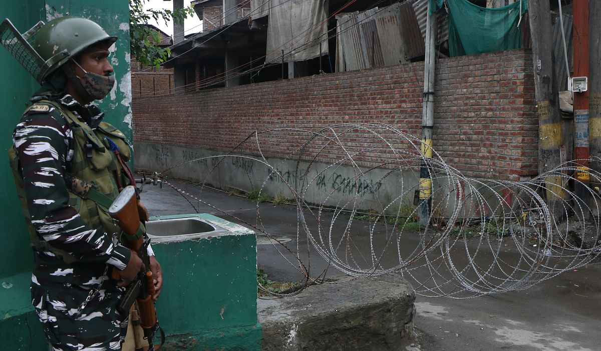 A paramilitary soldier stands alert during an ongoing shutdown in Srinagar on Martyrs' Day on July 13, 2021.