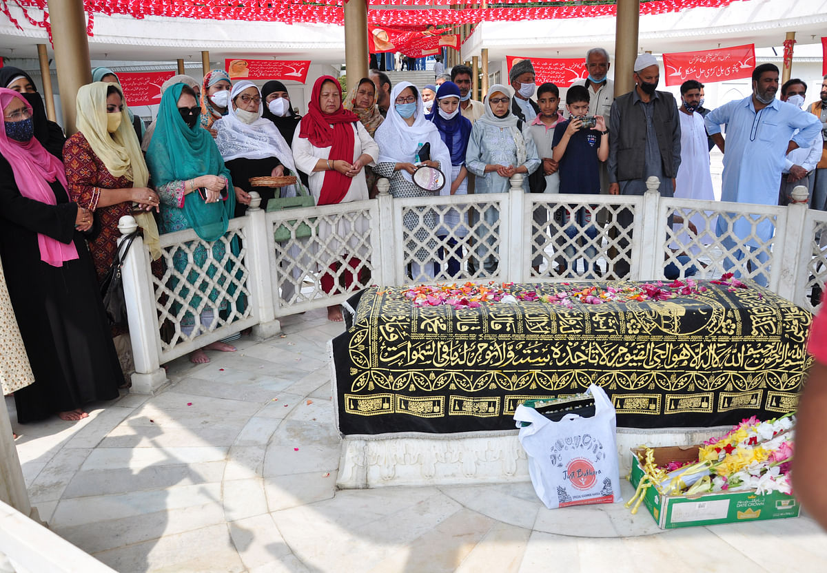 Jammu and Kashmir National Conference members pay tributes to Begum Akbar Jehan, ex-MP and wife of National Conference founder Sheikh Muhammad Abdullah on her 21st death anniversary at her grave Hazratbal in Srinagar on Sunday, July 11,2021