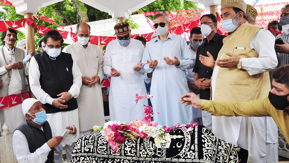 Jammu and Kashmir National Conference Party President and MP Dr. Farooq Abdullah, son Omar Abdullah, and senior party leaders pay tributes to Begum Akbar Jehan, ex-MP and wife of NC founder Sheikh Muhammad Abdullah on her 21st death anniversary at her grave Hazratbal in Srinagar on Sunday, July 11,2021