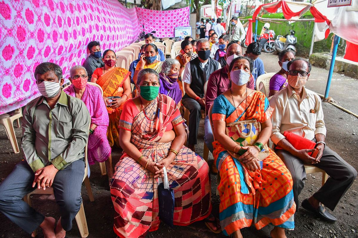Residents await for the arrival of daily doses after a hiatus to get inoculated with a dose of the Covishield, AstraZeneca-Oxfords Covid-19 coronavirus vaccine, during a vaccination drive in Mumbai July 12, 2021.