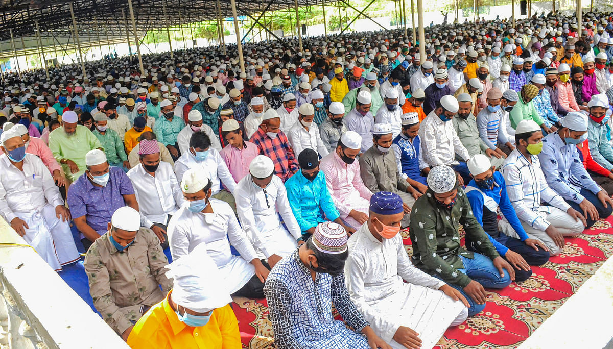 Muslims offer prayers at a market on the occasion of Eid al-Adha, in Coimbatore, Wednesday, July 21, 2021.