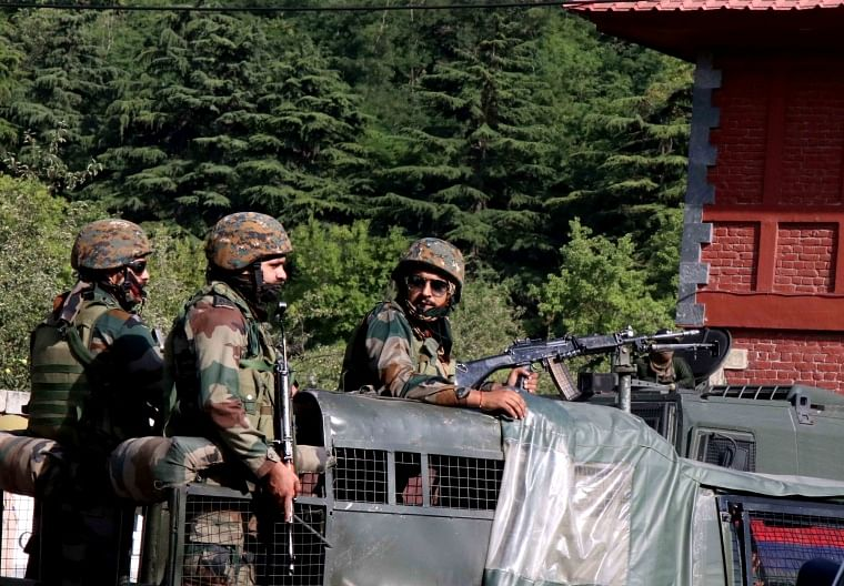 Security personnel stand guard as members of Delimitation Commission arrive to meet leaders of different political parties, in Srinagar.