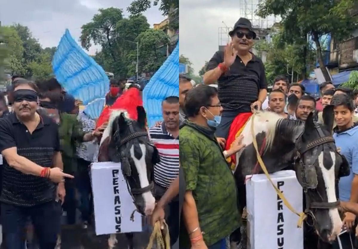 Pegasus spyware row: TMC MP Madan Mitra walks blindfolded, protests with horse in Kolkata