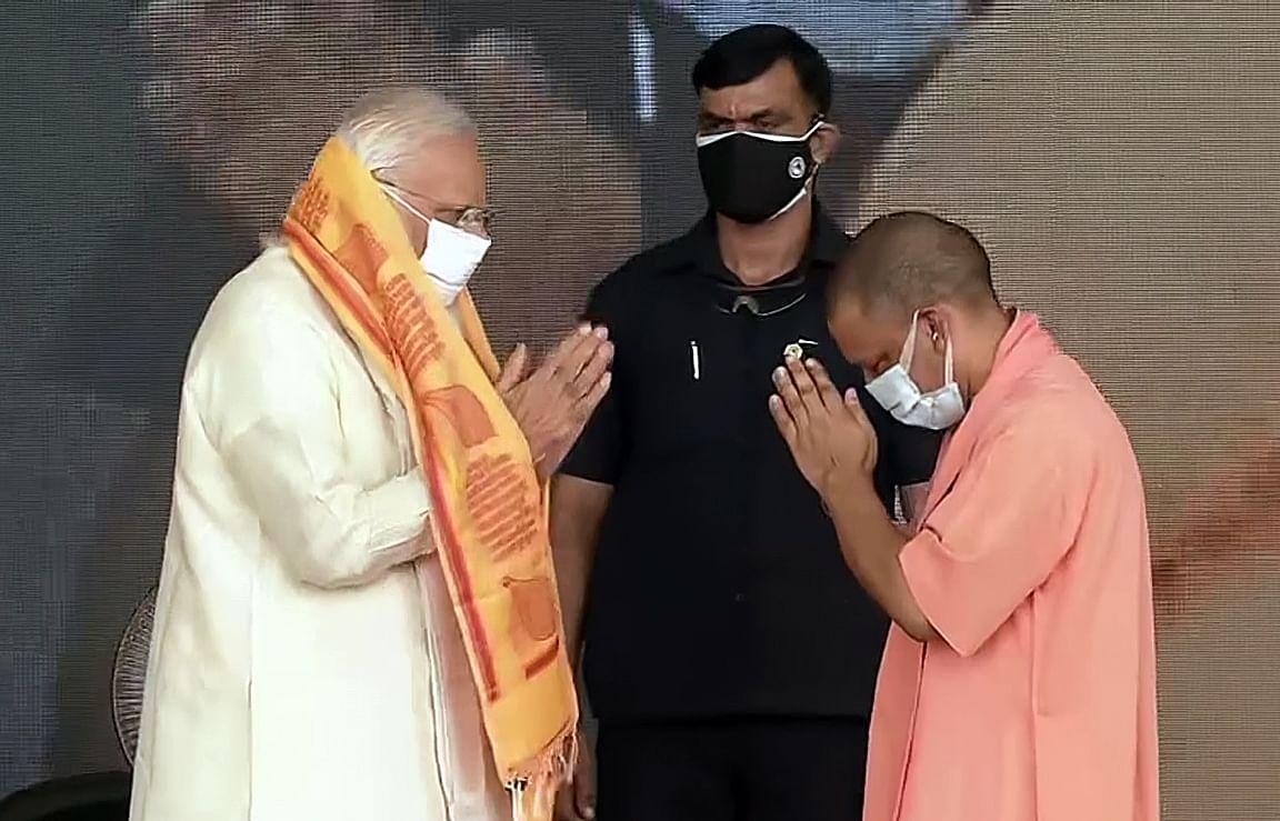 Uttar Pradesh Chief Minister Yogi Adityanath and Prime Minister Narendra Modi greet each other during the inauguration ceremony at Banaras Hindu University, in Varanasi on Thursday.