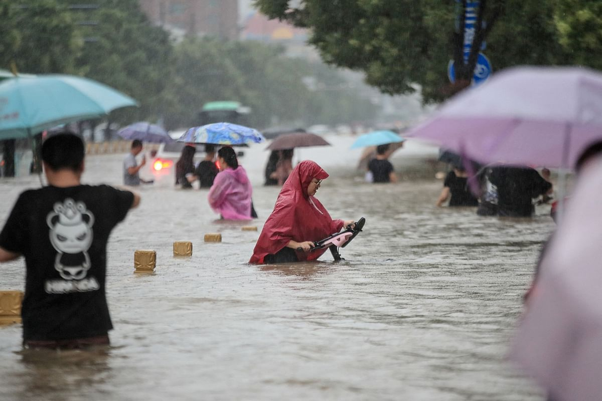 Watch video: At least 25 killed as heaviest rainfall in 1,000 years hits Central China's Henan province