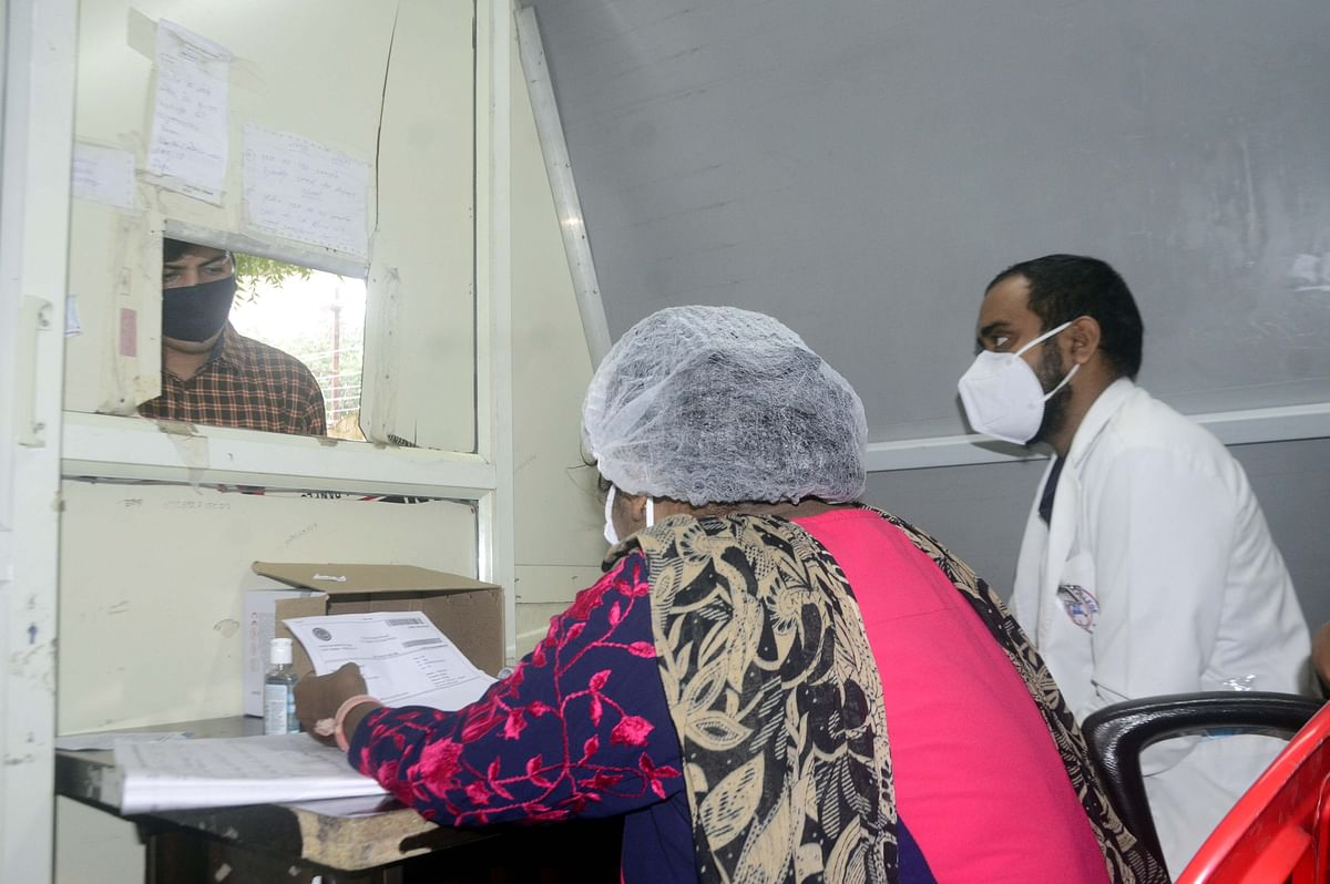 Health workers collect sample for Corona testing