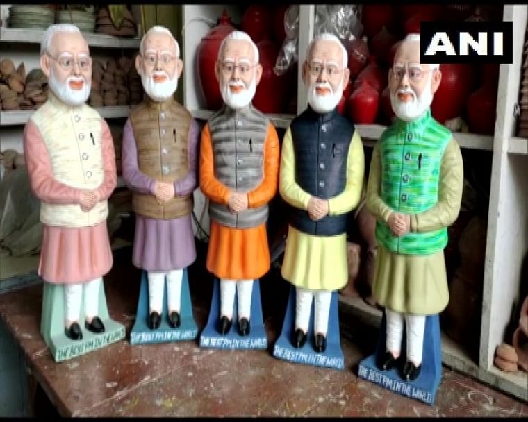 In pics: Bihar sculptor makes PM Modi's statues to use as money storage bank