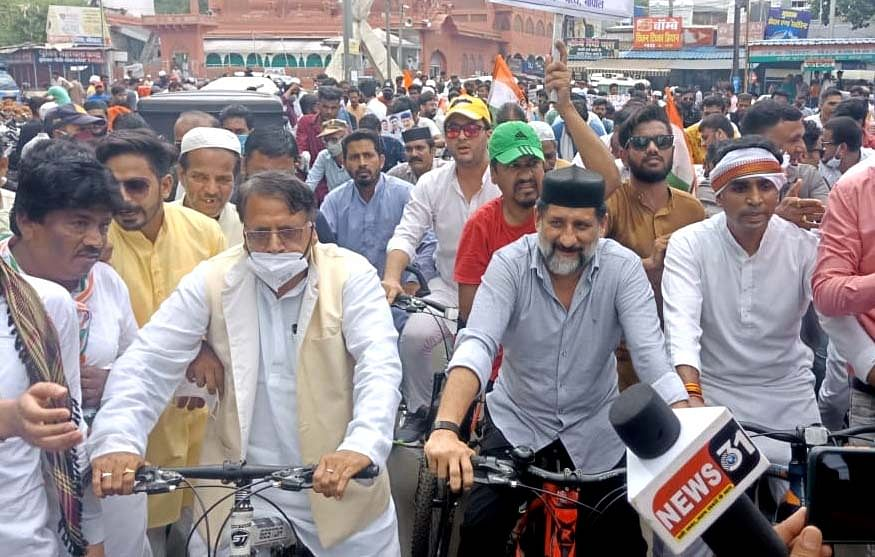 Former minister PC Sharma, Congress MLA Arif Masood participating in rally